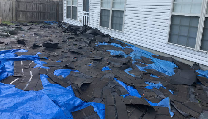 tarp on ground to catch roof tear off 6-26-17