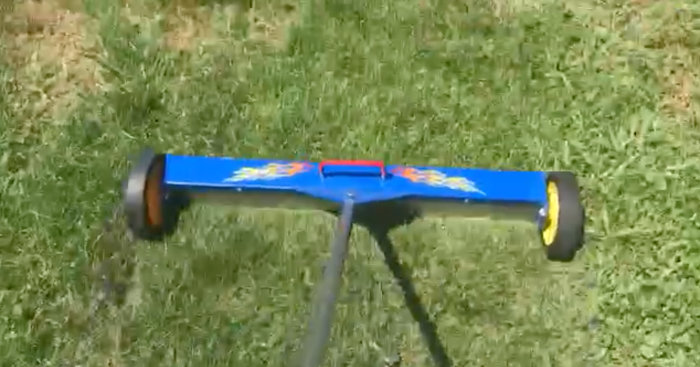 yard magnet picking up roofing nails in grass 6-26-17