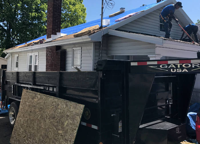 trailer onsite to catch roofing tear off debris